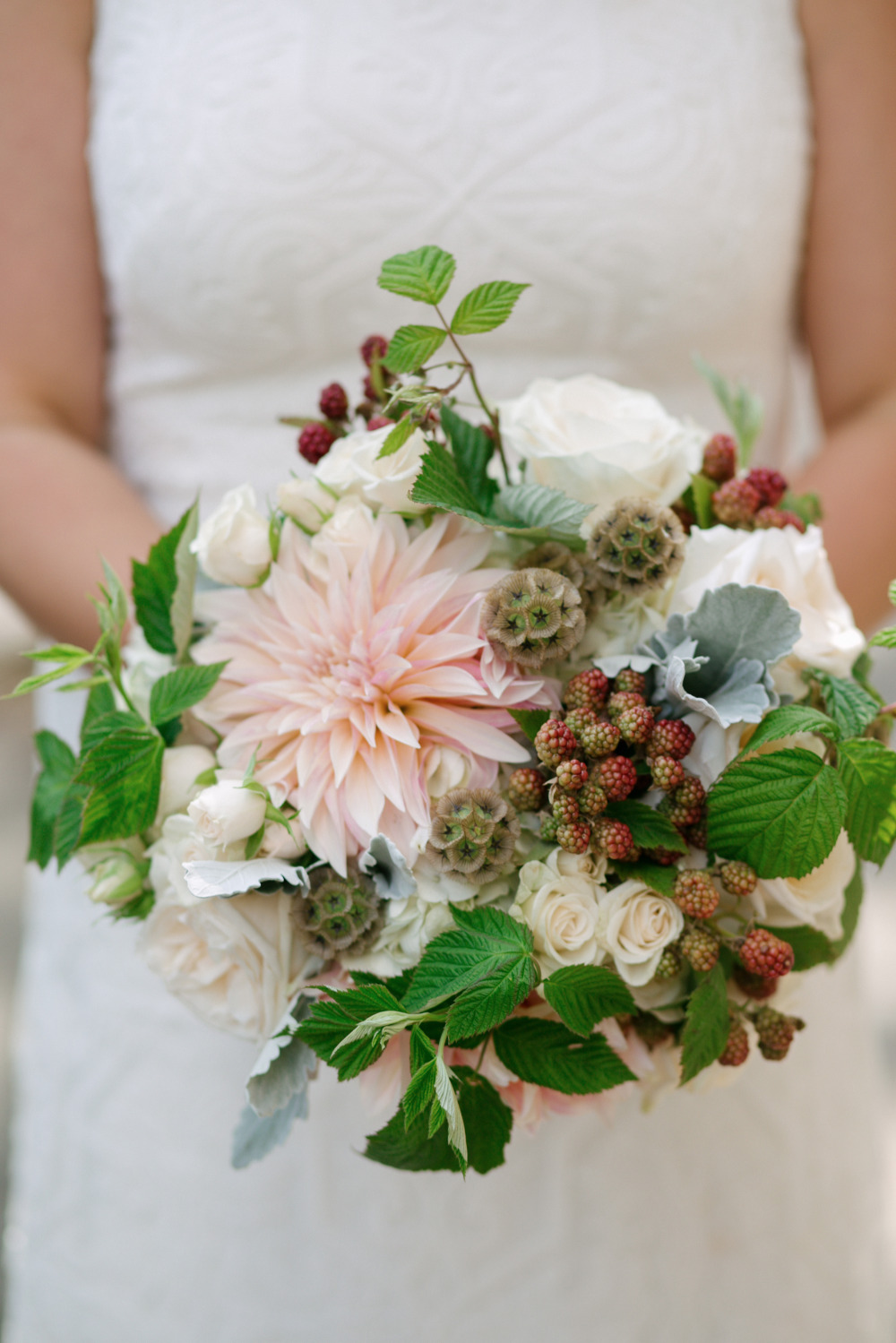 dahlia roses and berries wedding bouquet