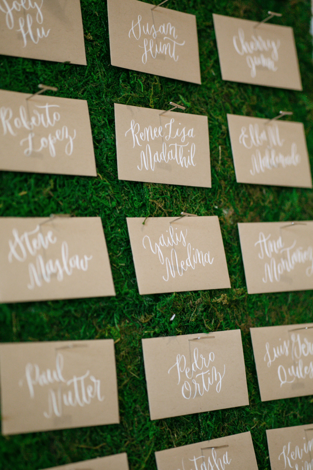 kraft paper and white script escort cards
