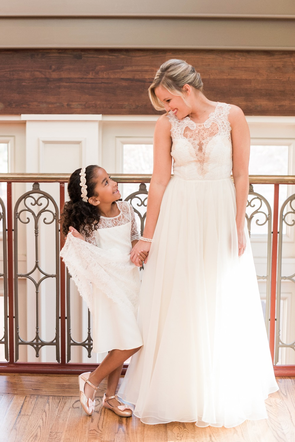 adorable bride and her flower girl