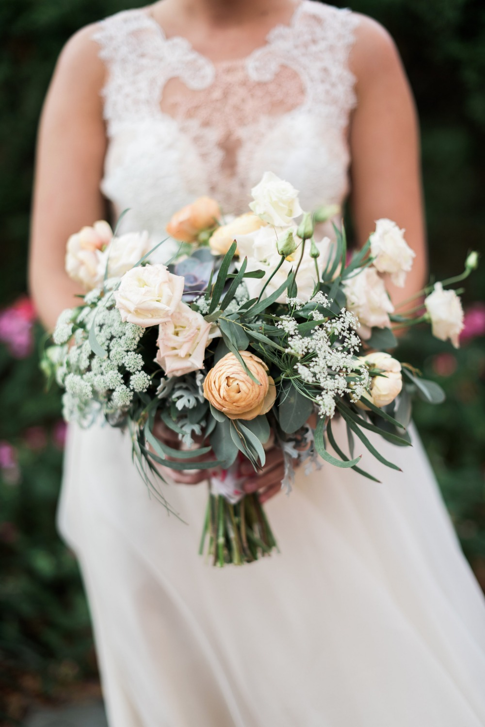 wedding bouquet with roses and queen annes lace