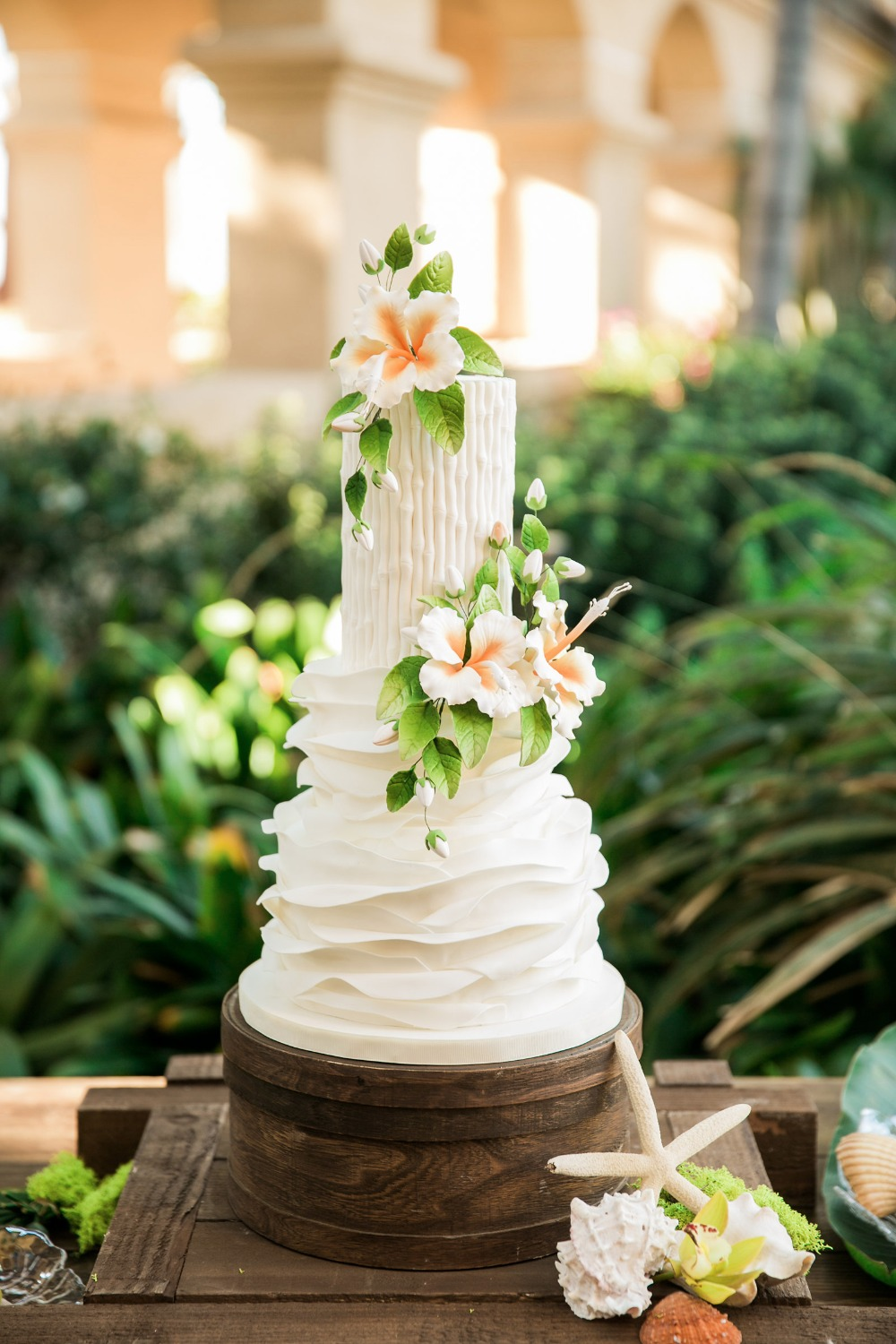 Tropical white wedding cake with flowers