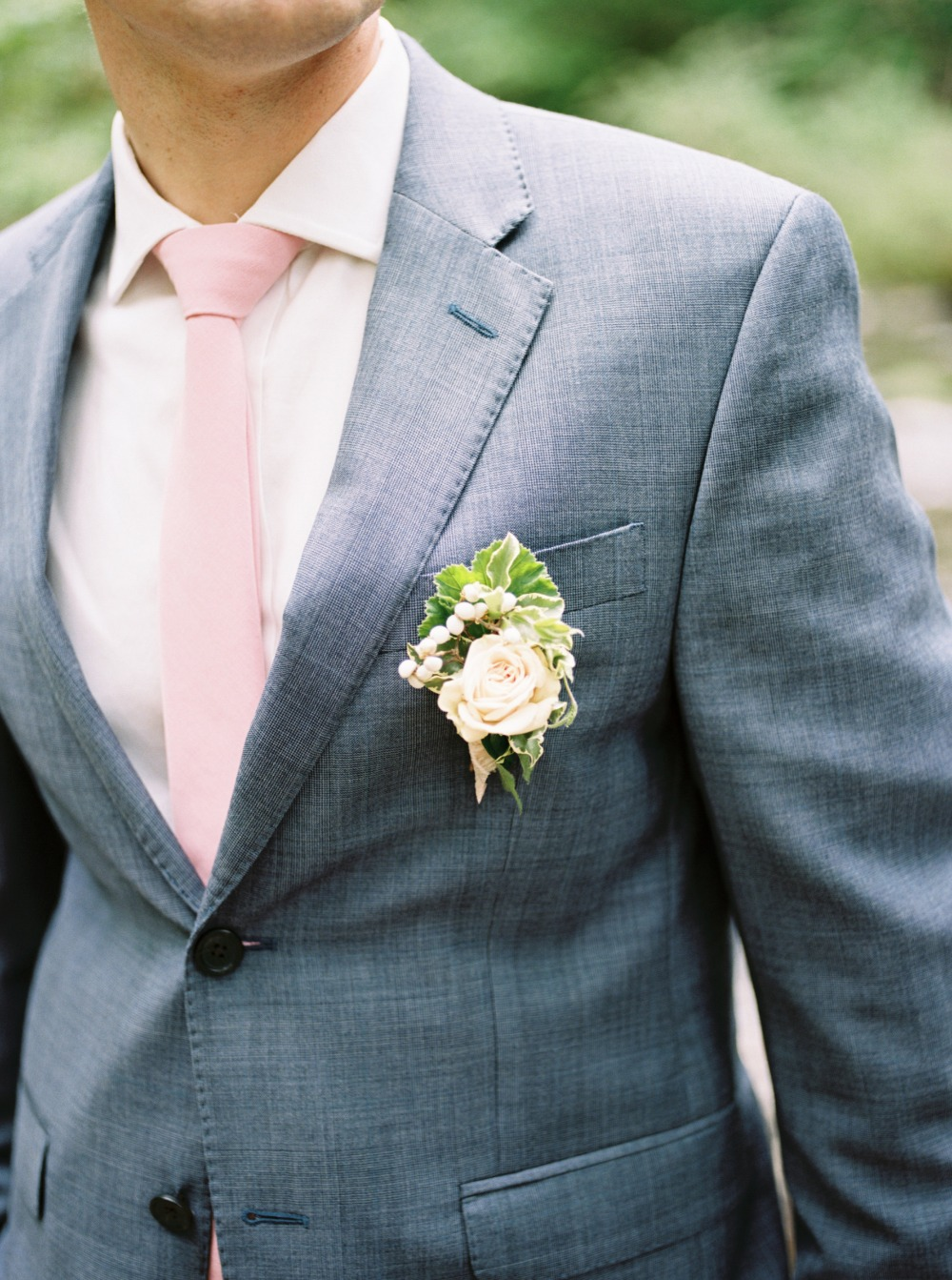 Grey suite with blush tie