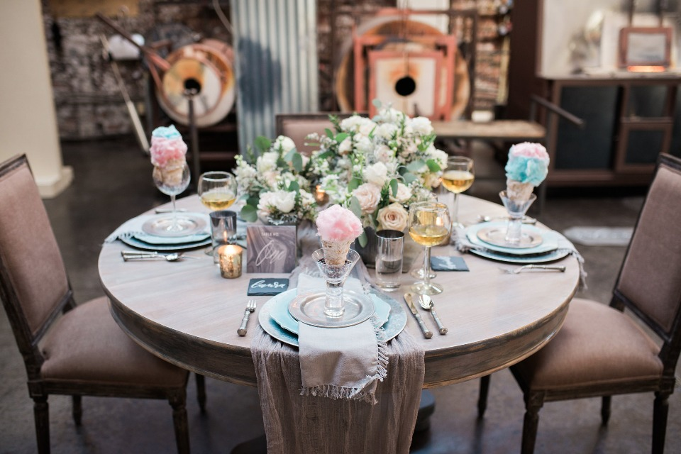 wedding table with cotton candy at each place setting