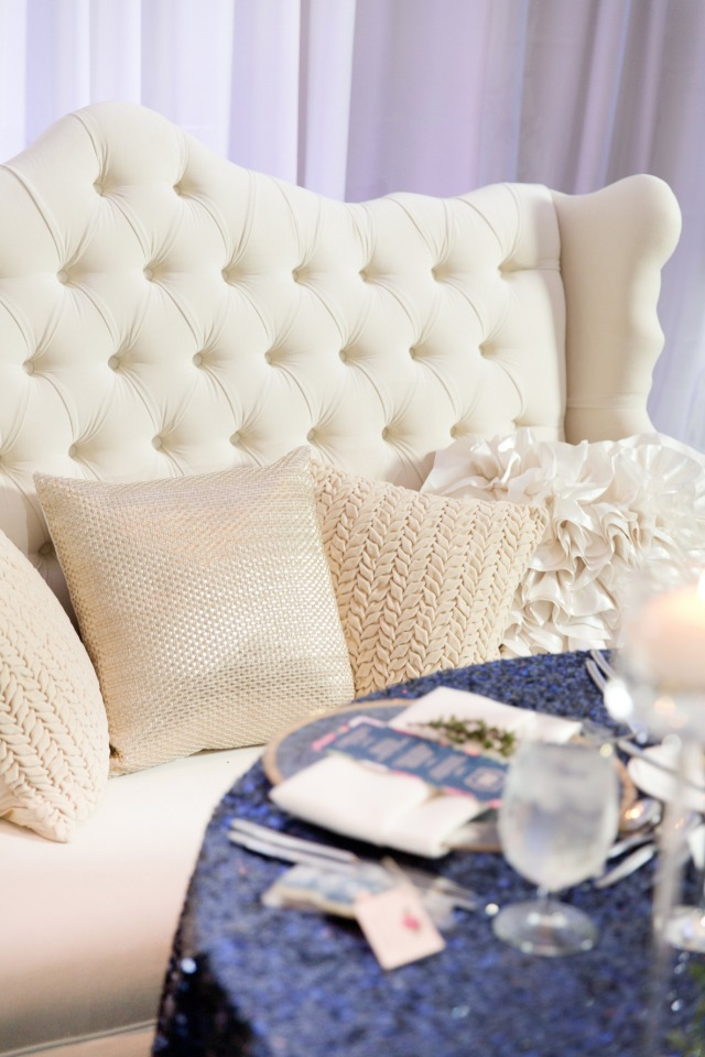 plush love seat for the newlyweds at the sweetheart table