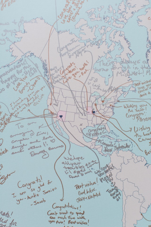 have your guests sign a world map for a fun piece of art for you new home