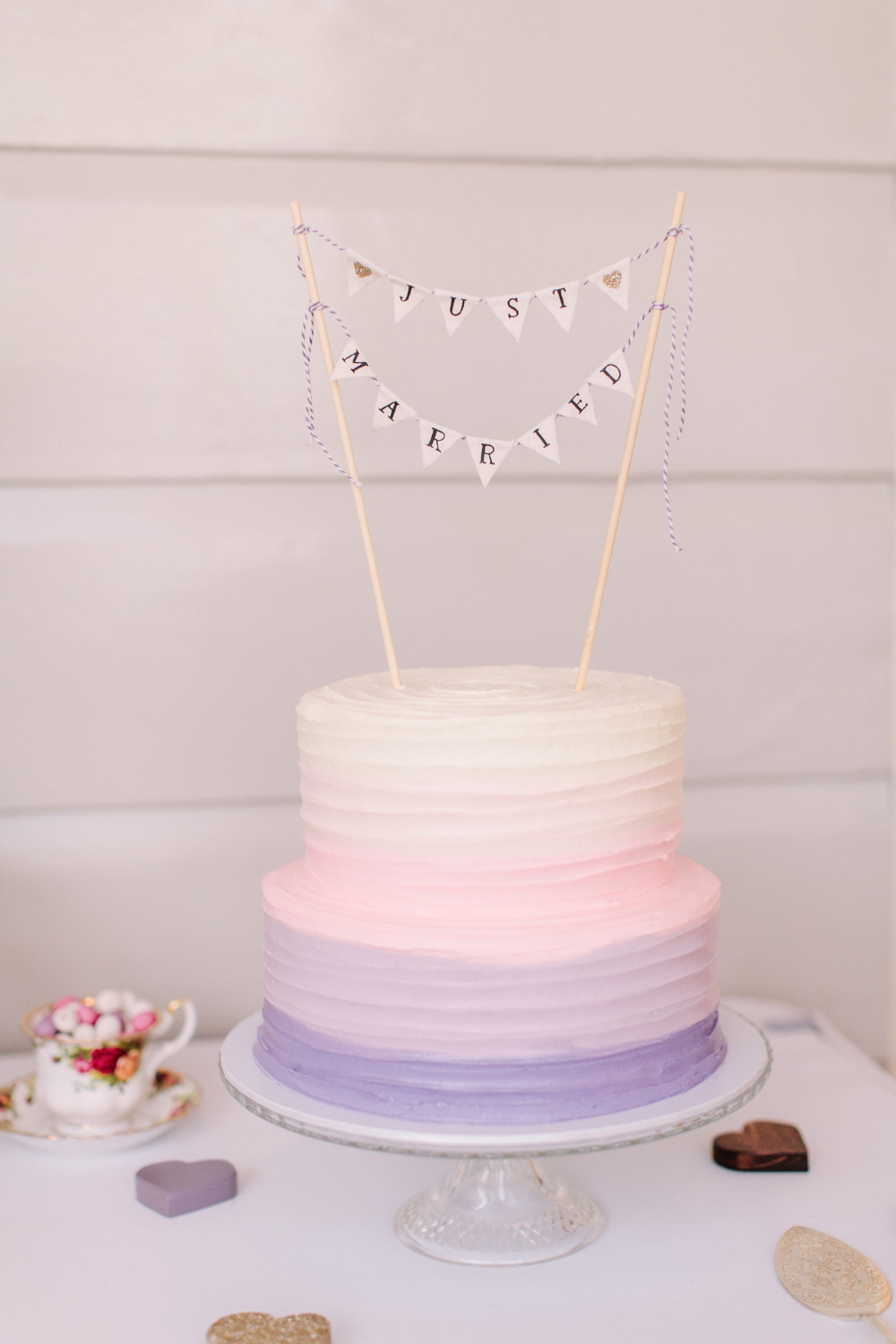 purple ombre wedding cake with bunting
