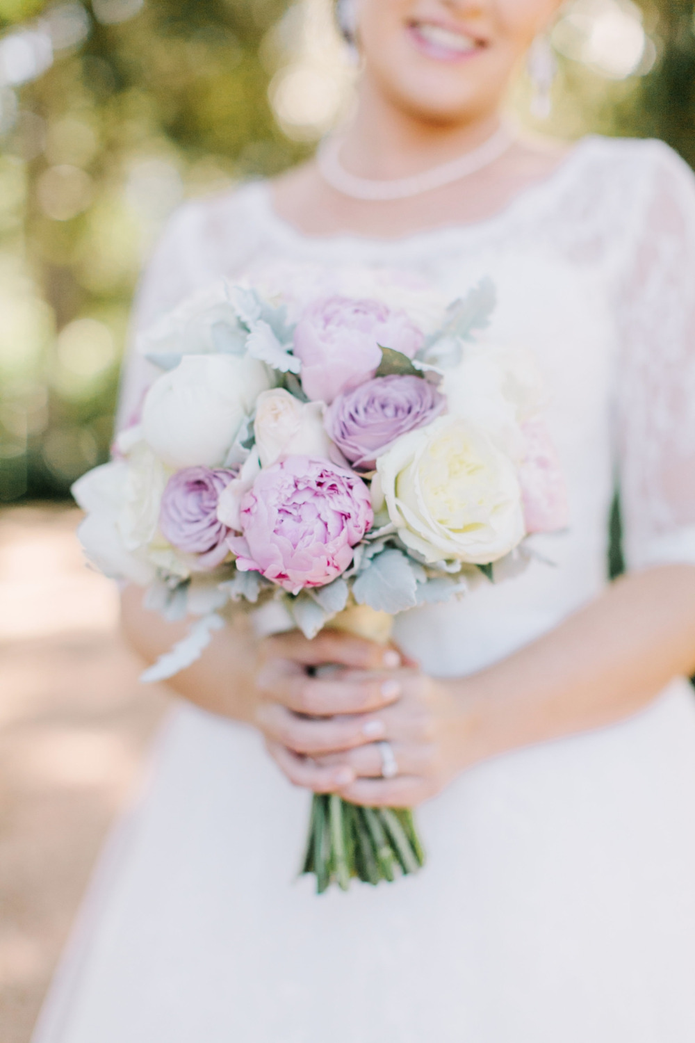 purple and white peony and rose bouquet