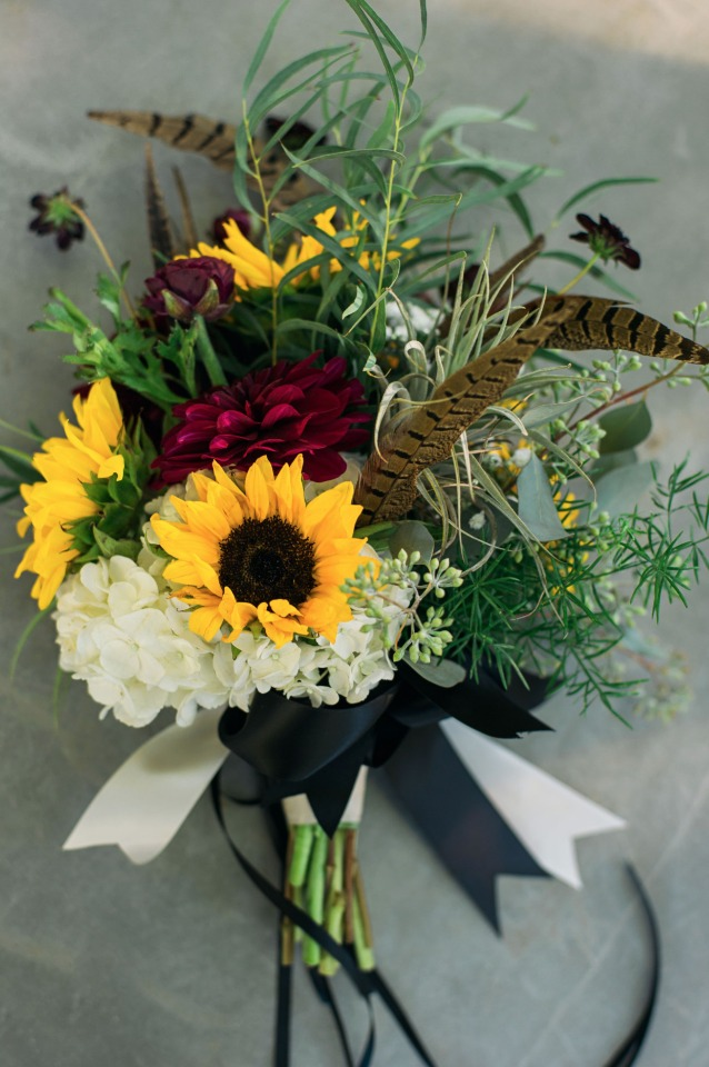 feather and sunflower wedding bouquet