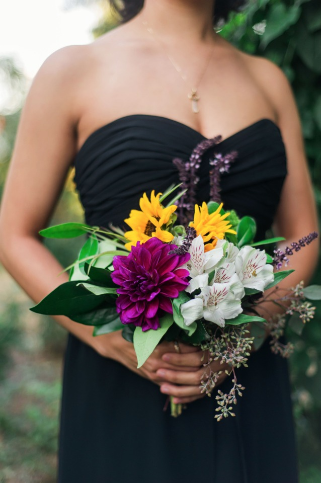 black bridesmaid dress with brightly colored bouquet