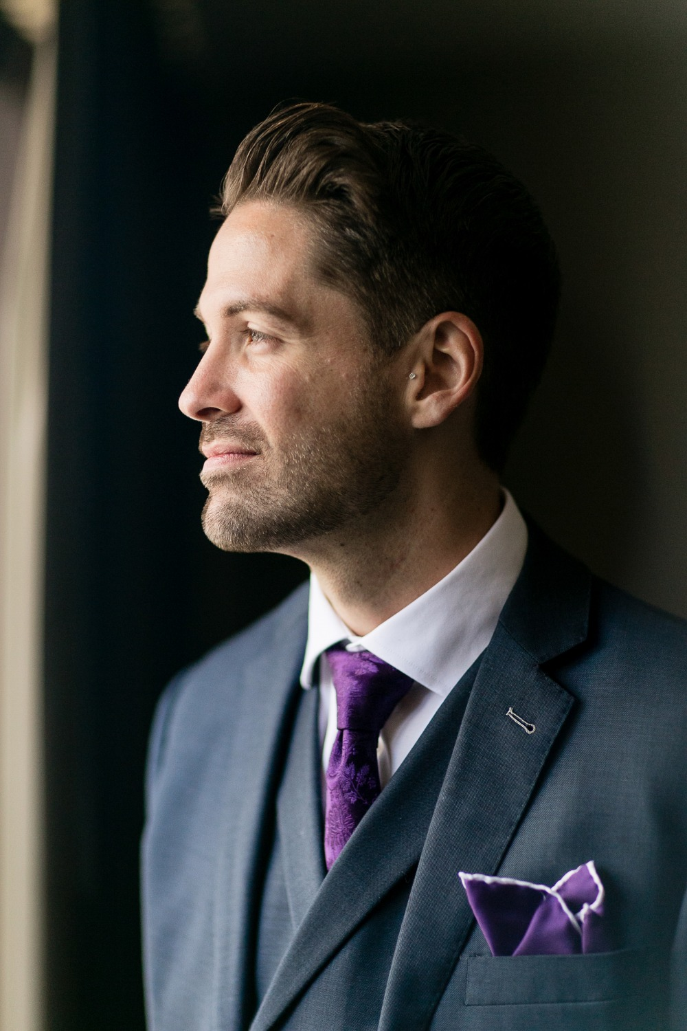 Groom in navy and purple