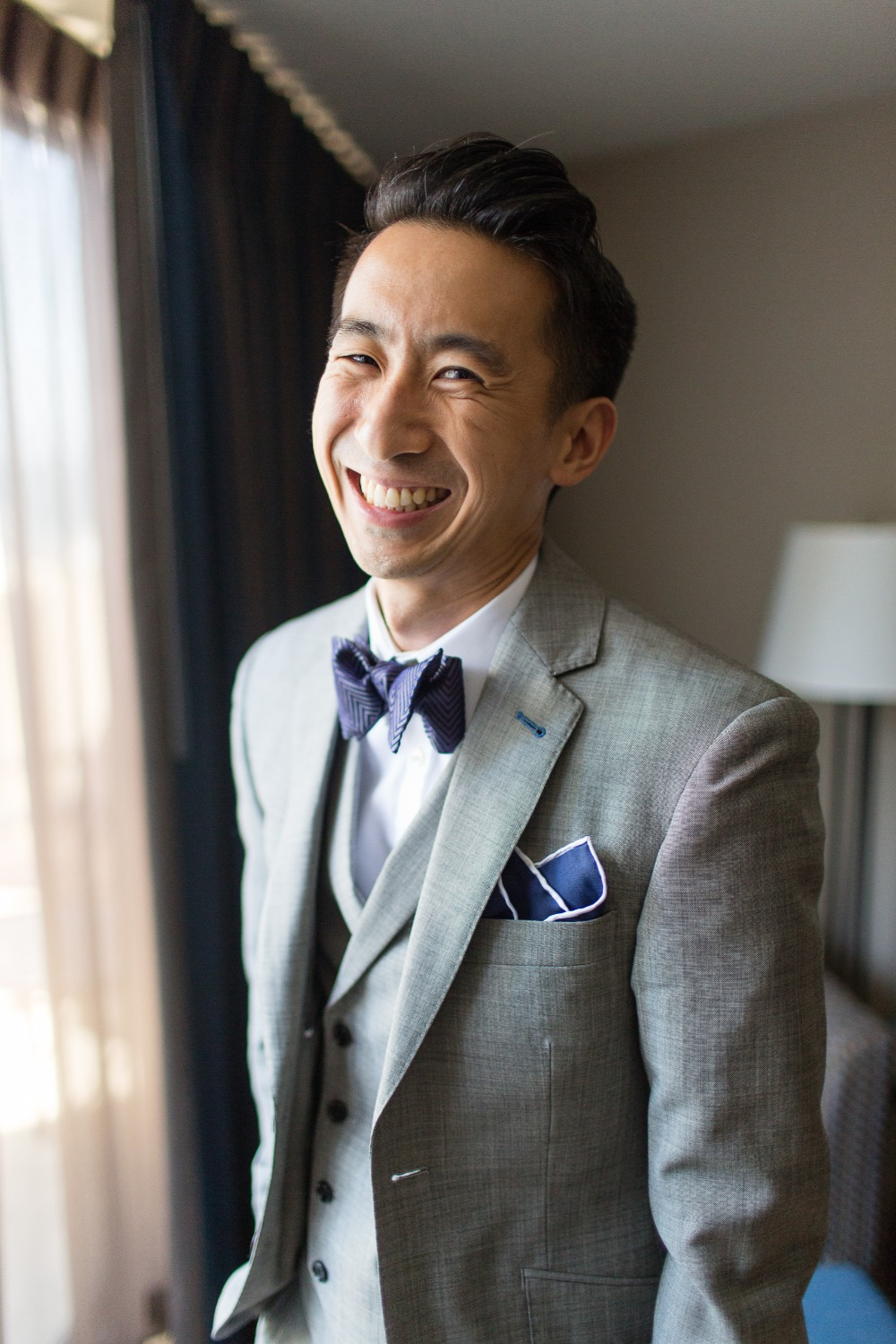 Groom in gray suit with bowtie