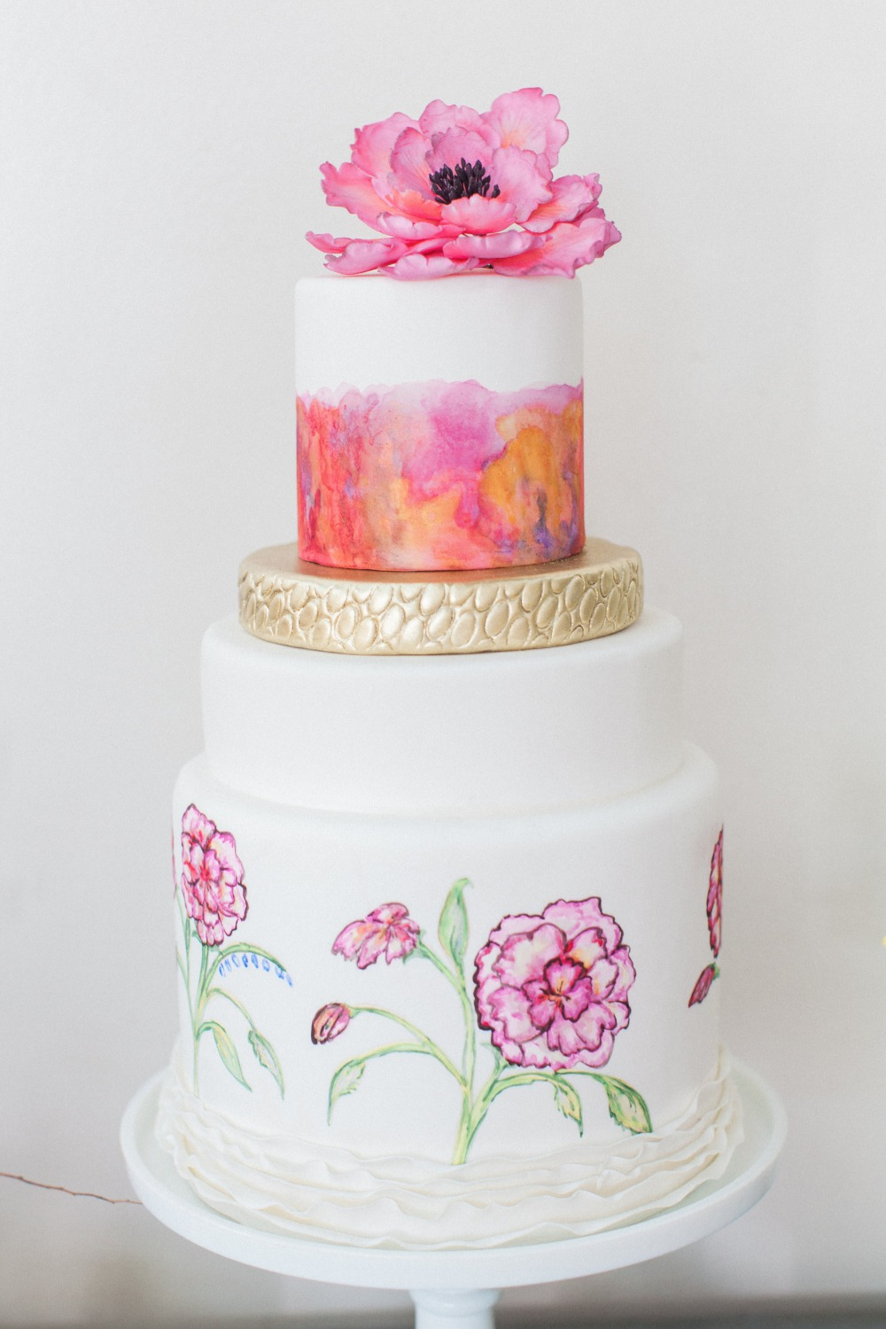 Pink orange and gold wedding cake