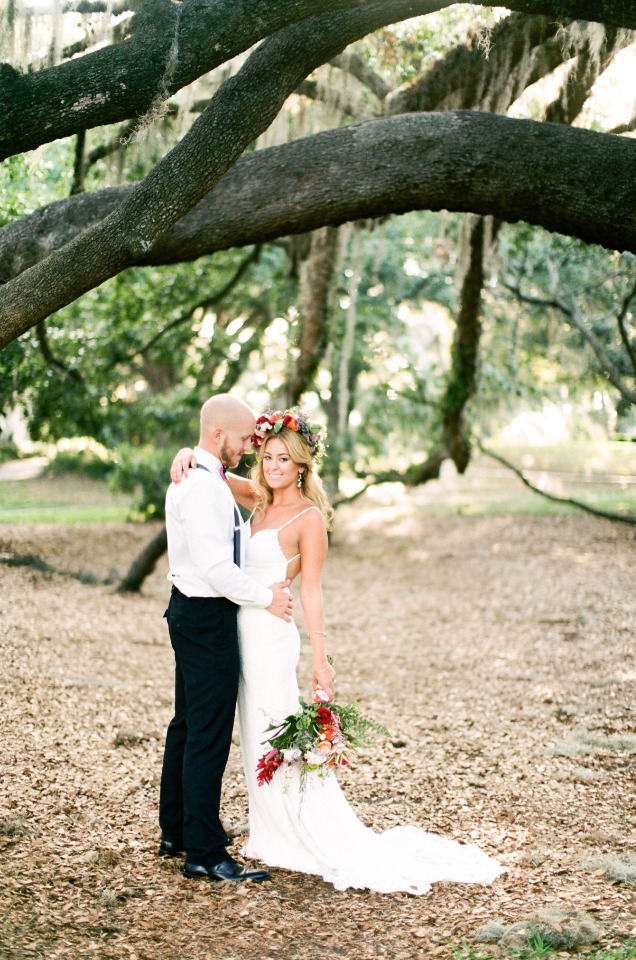 boho bride with groom in classic suspenders and bow tie