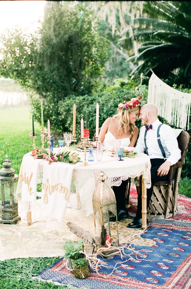 funky boho chic bride and groom sweetheart table