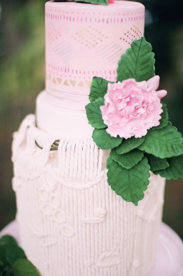 macrame wedding cake with a pink ombre