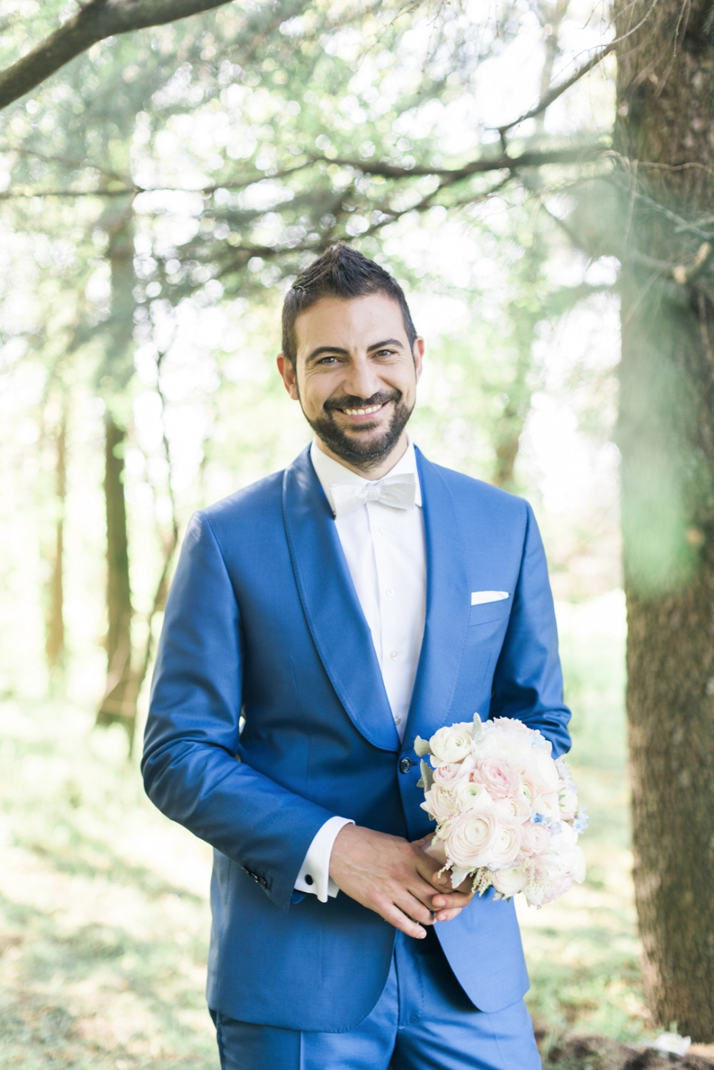 groom in bright blue