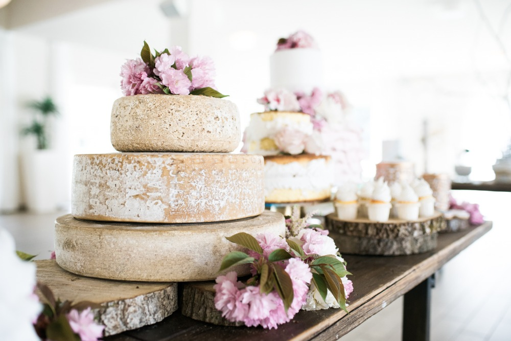 stacked wheels of cheese make a fun spin on wedding cake