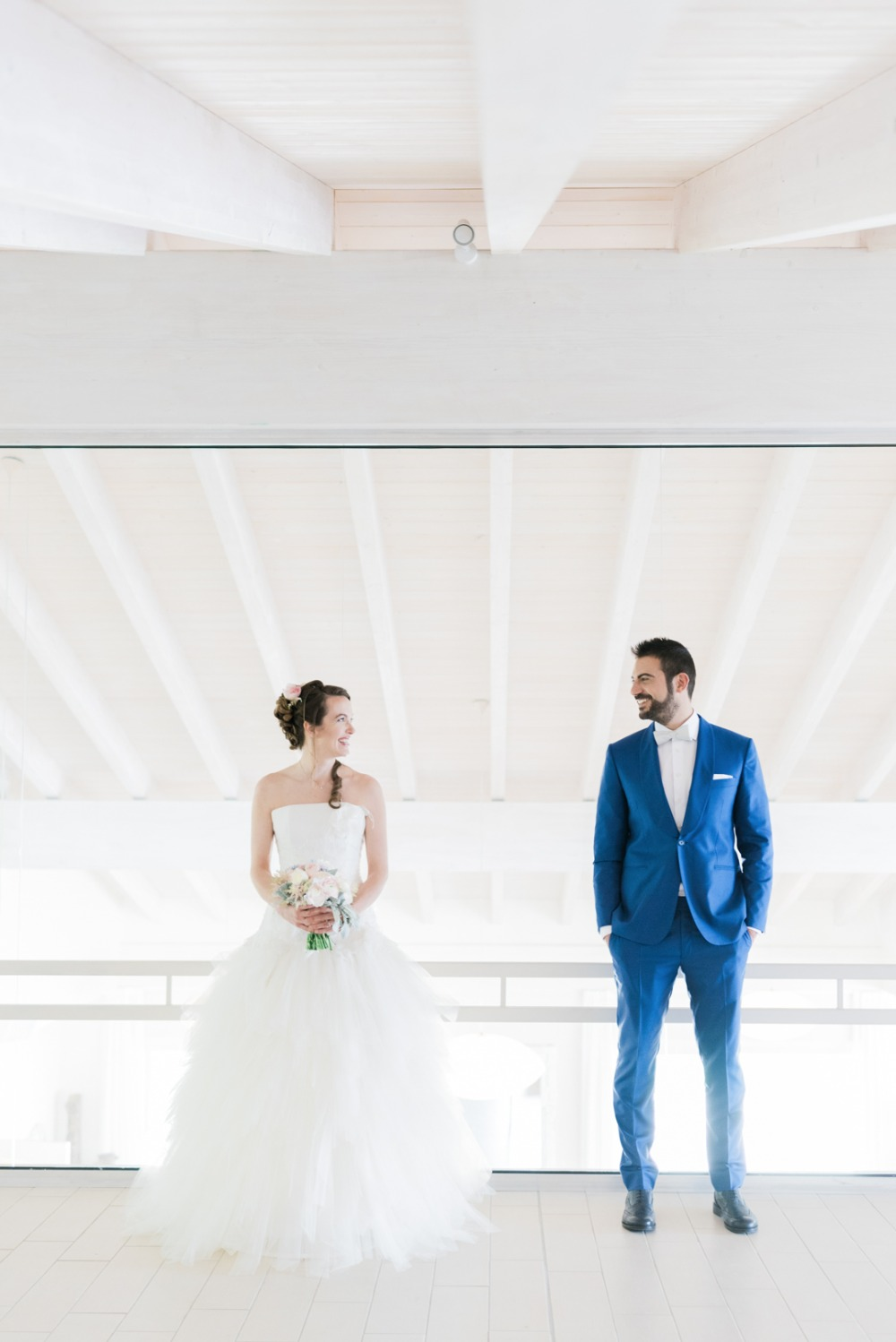 royal blue groom suit and classic bride in wedding gown
