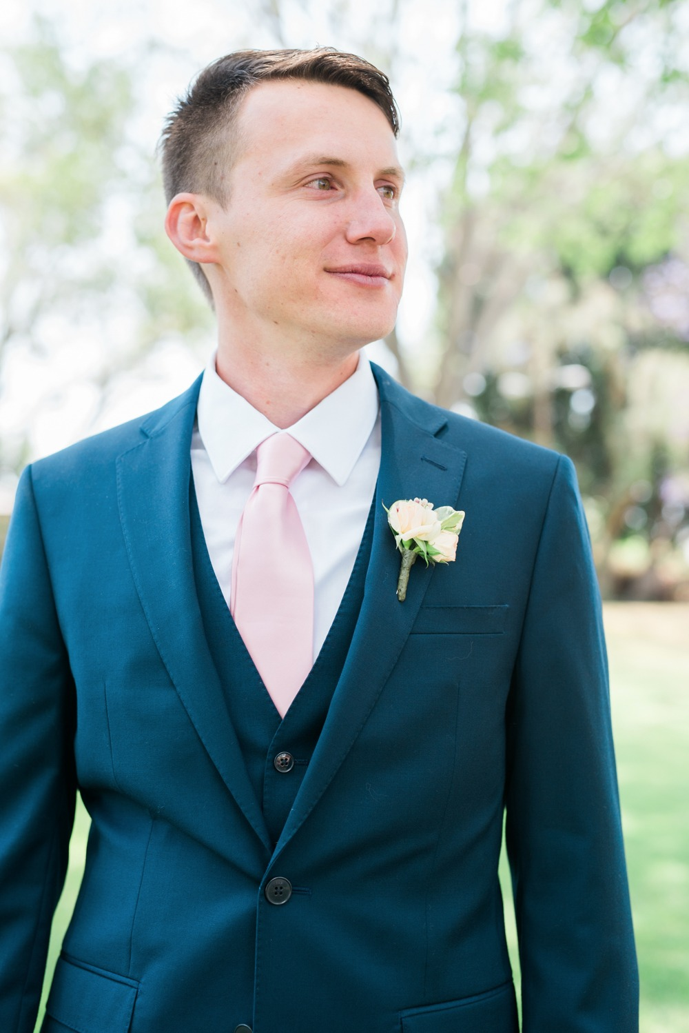Groom look in Navy with blush tie