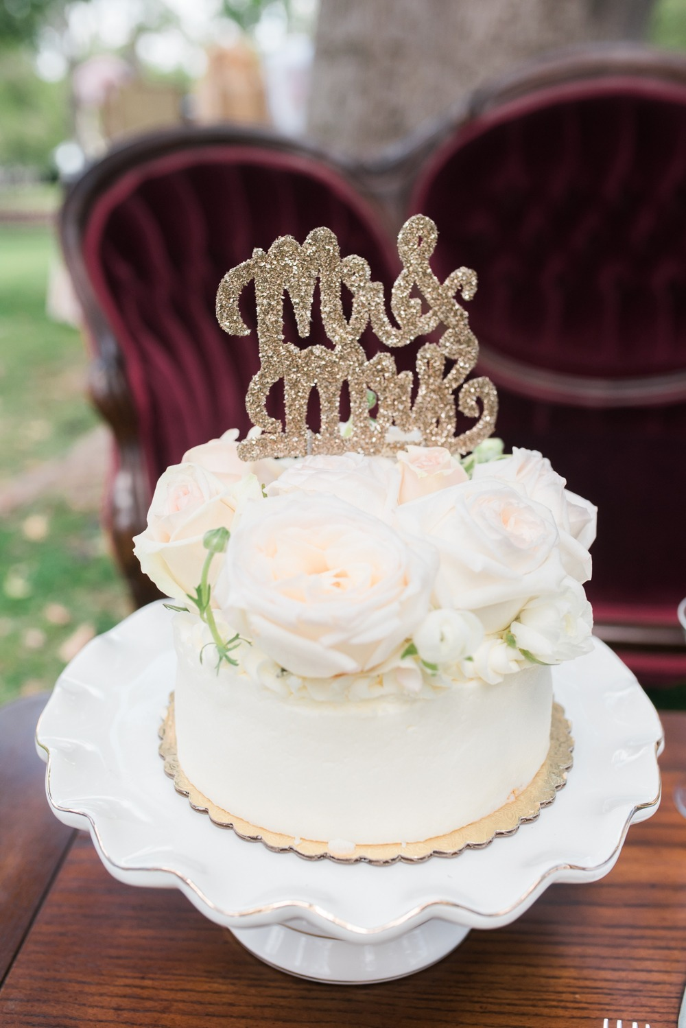 Simple wedding cake with gold sparkle topper