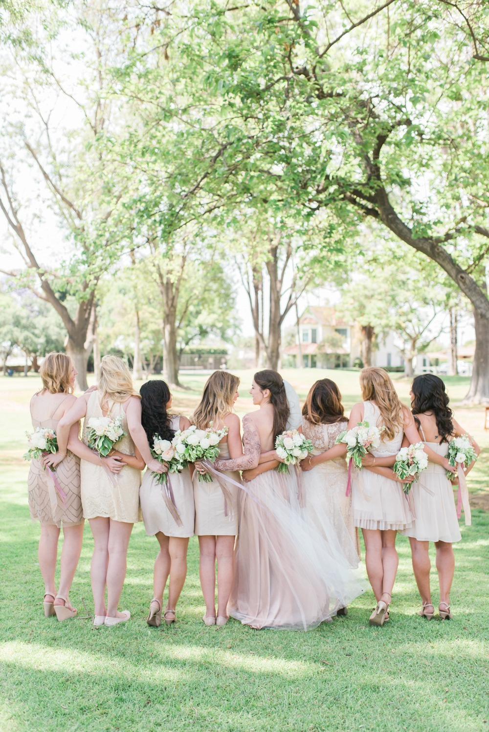 Bridesmaids in short mismatched dresses