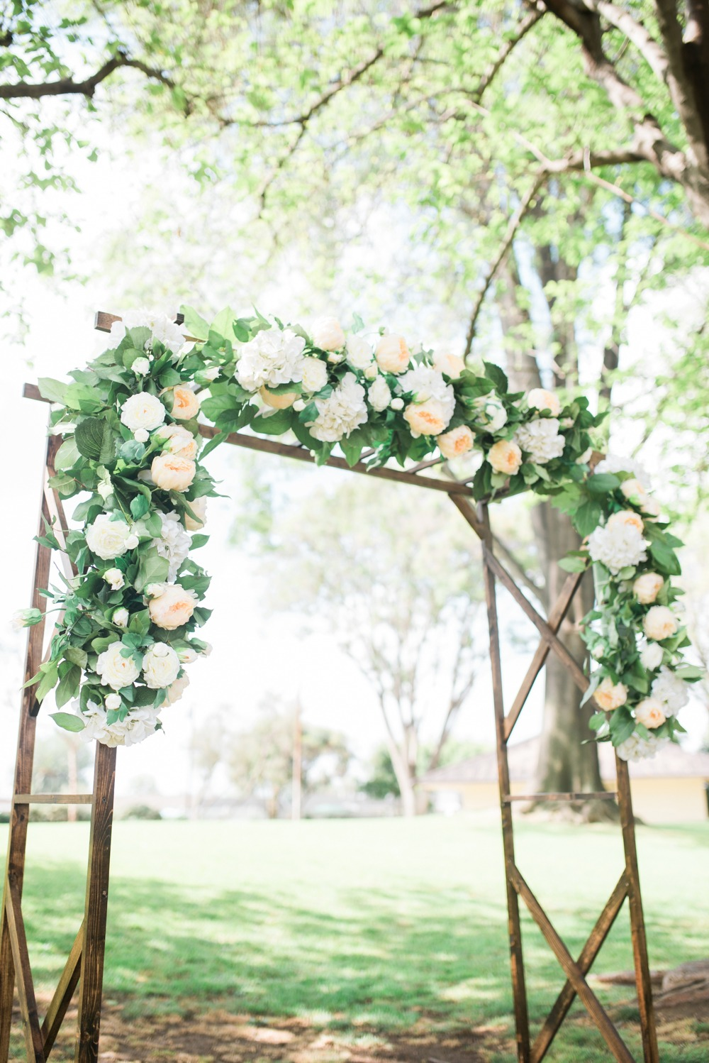 Chic ceremony arch with florals