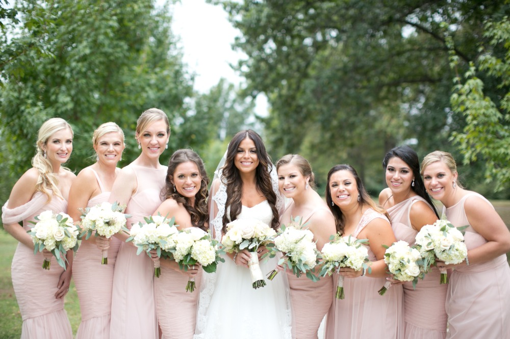 Bridesmaids in mix n match blush dresses