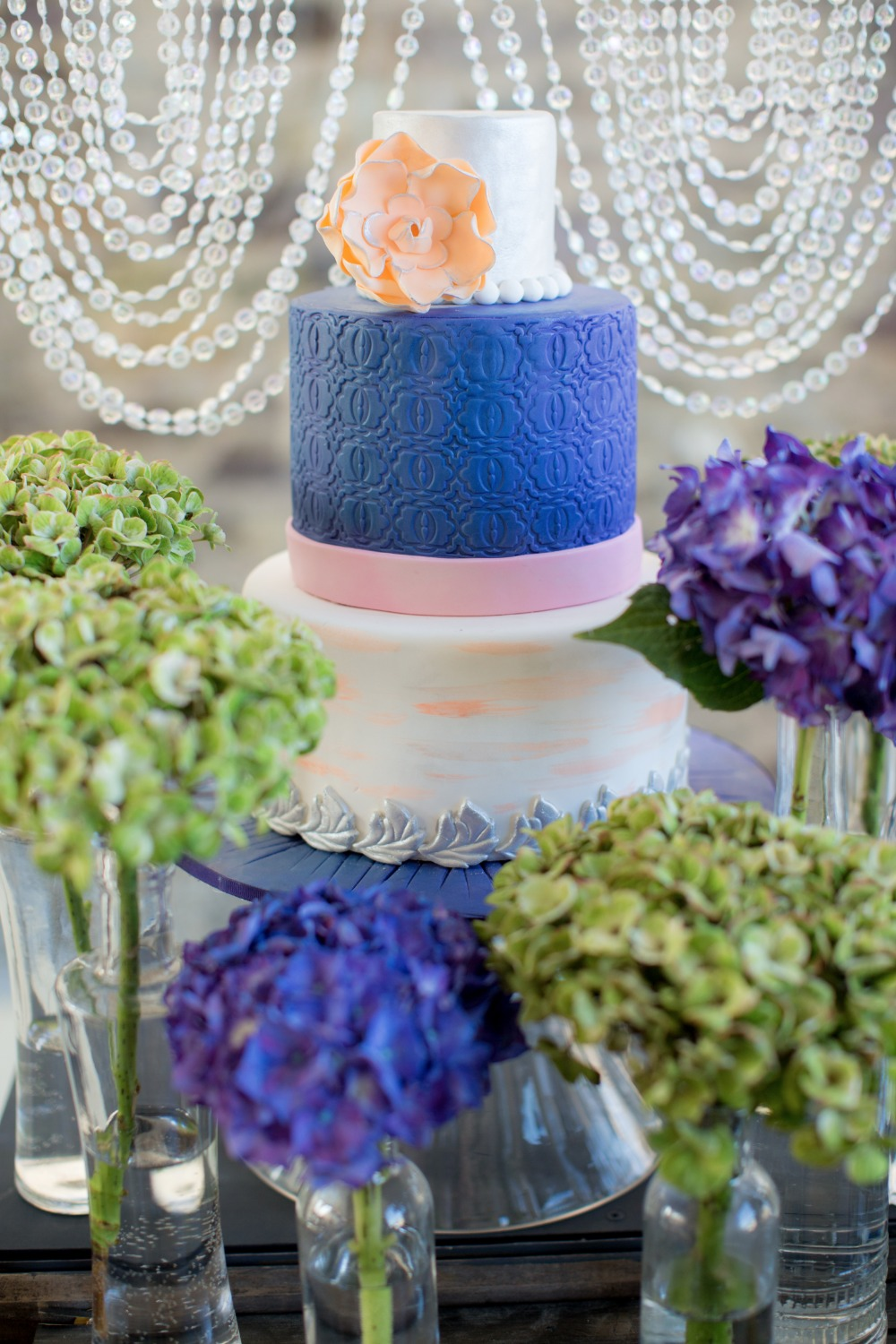 Pink blue and peach wedding cake