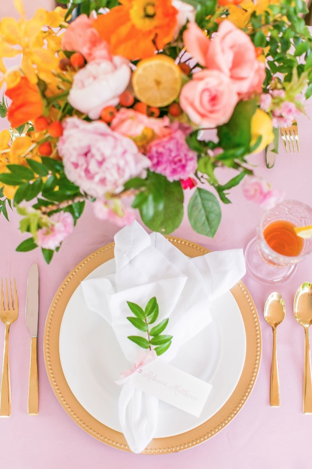 charming wedding place setting in gold pink and white