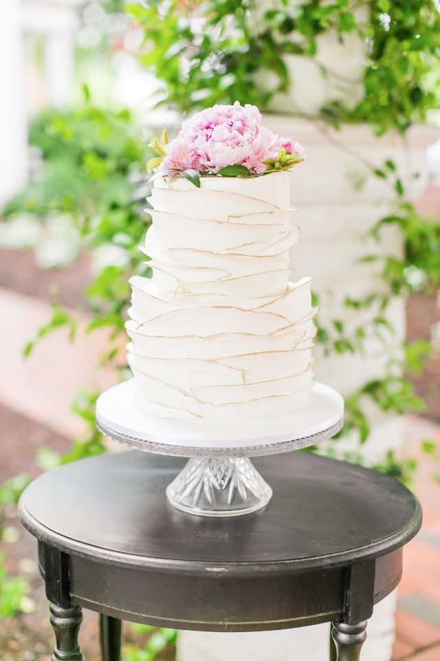 gold edged ruffle cake with beautiful flower topper