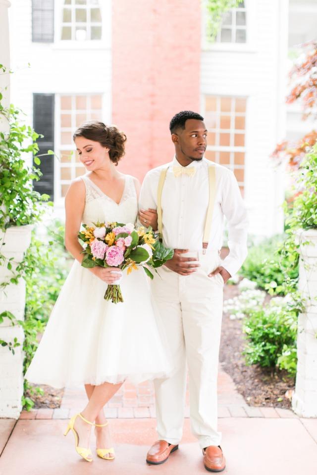 wedding couple in white and lemon yellow