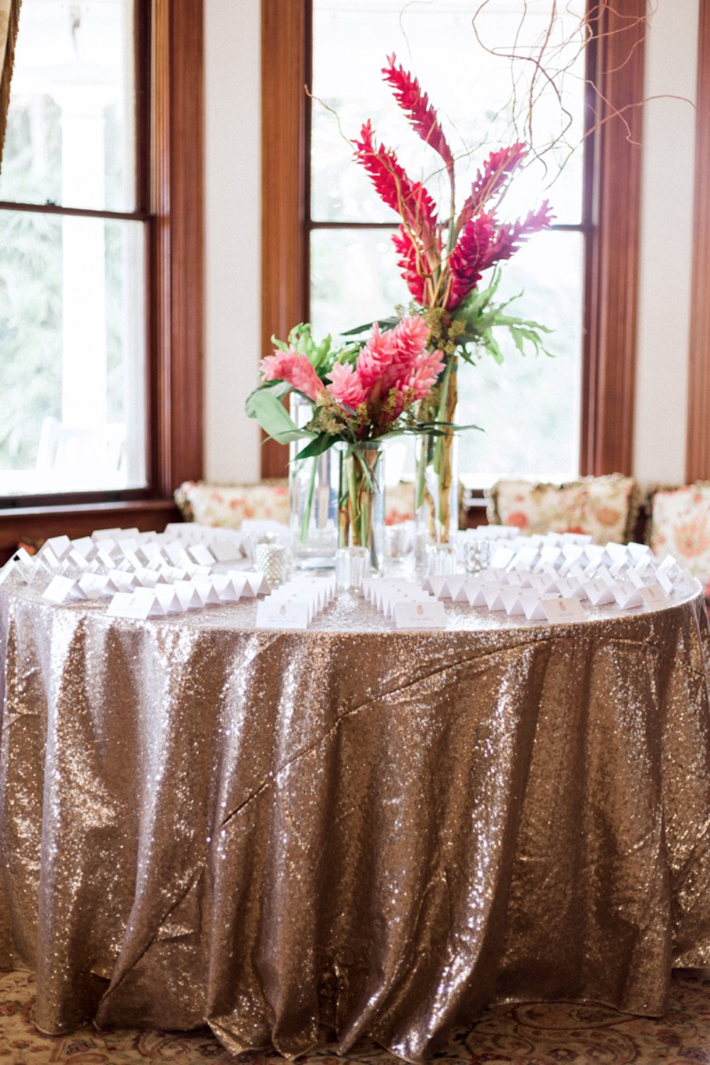 escort card table with flowers