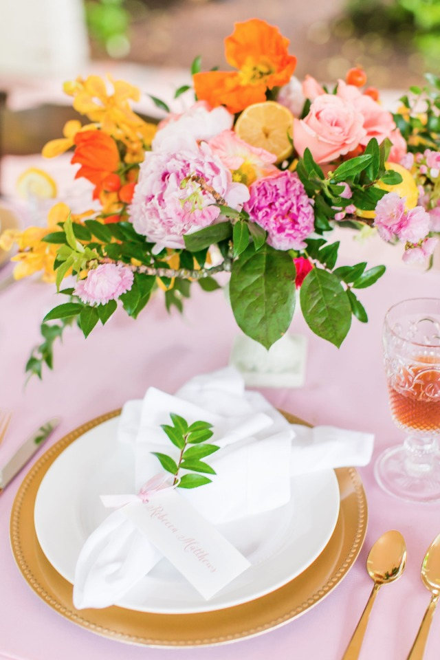 pink and gold wedding table decor with citrus inspired centerpiece