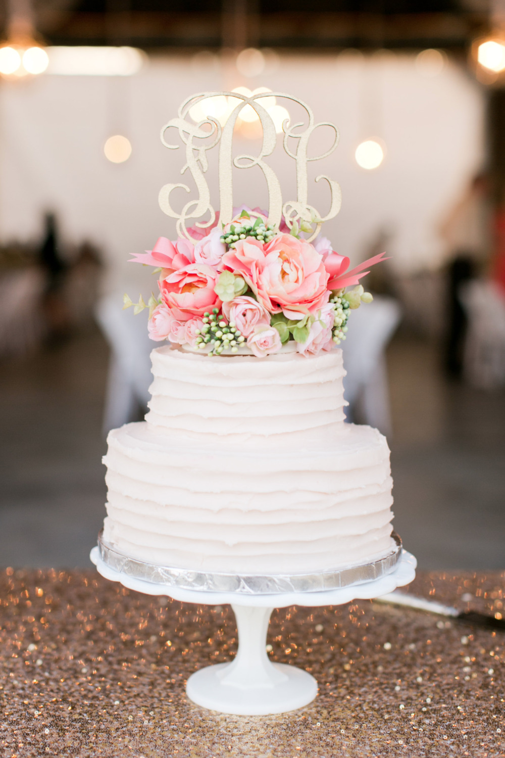 classic simple wedding cake with gold topper
