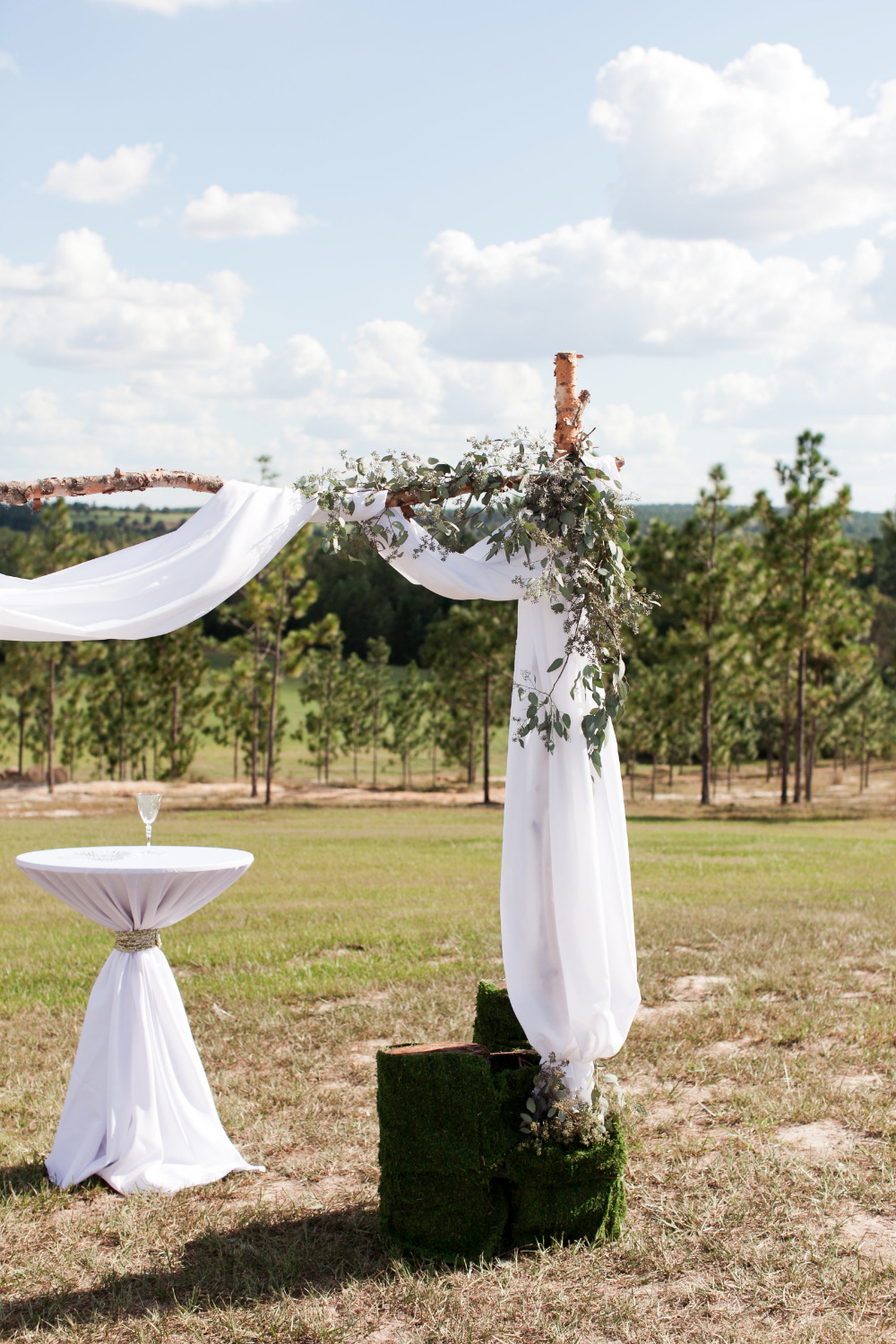 draped wedding arbor with tulle and garlands
