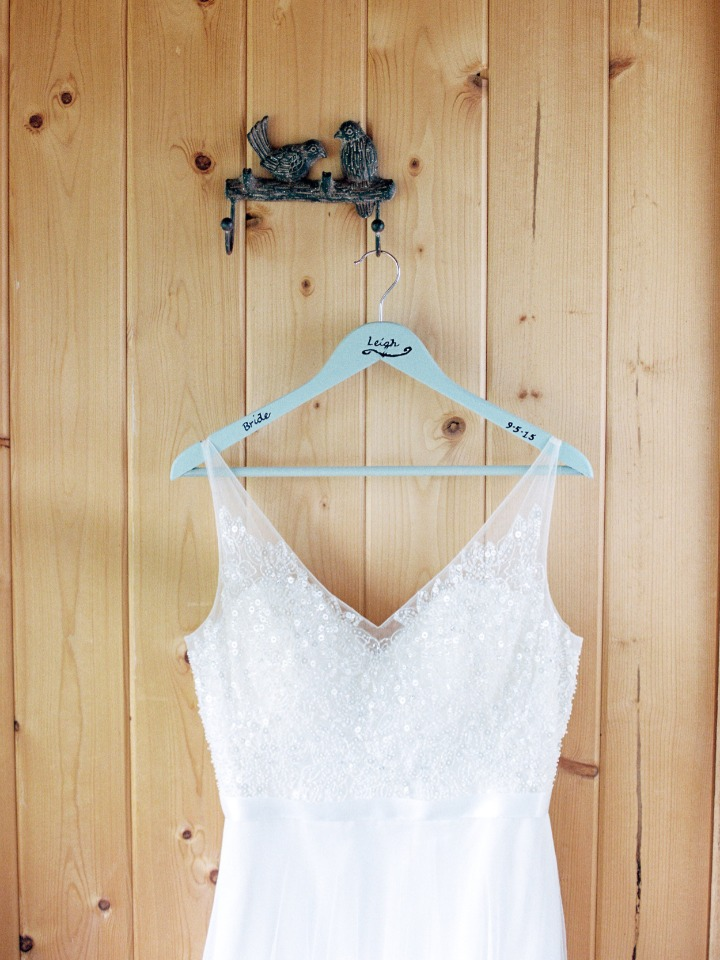 wedding dress hanger with name and wedding date on it