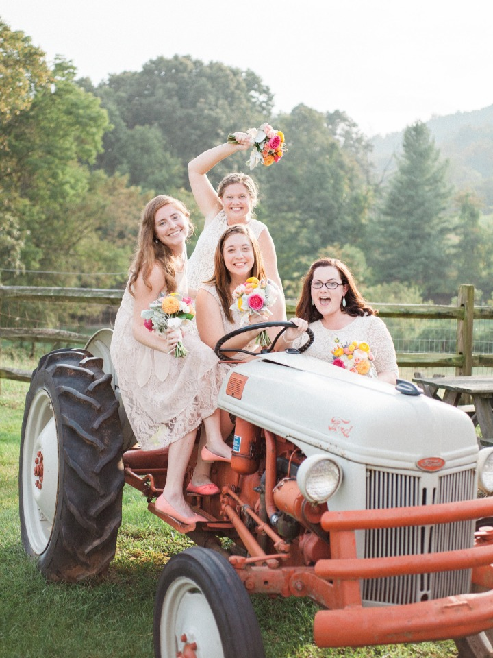 super fun bridesmaids photo idea with antique tractor