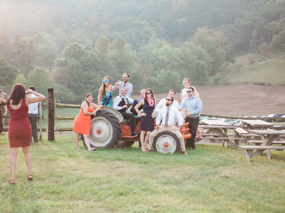 rustic photo booth idea with antique tractor