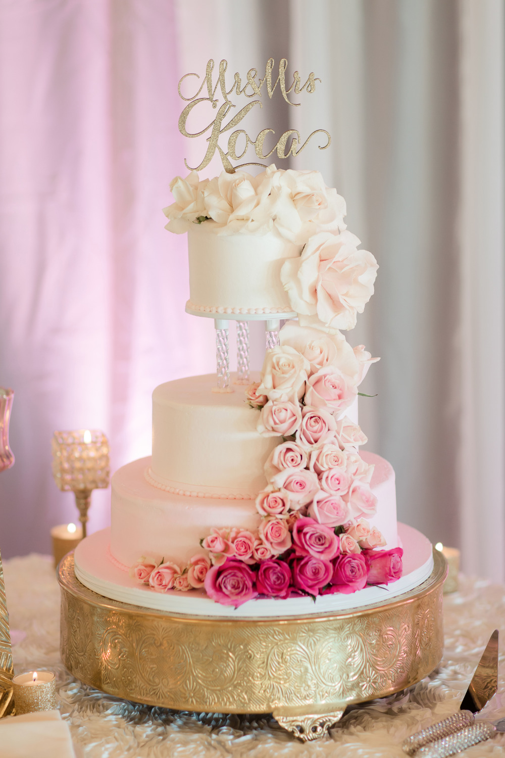 wedding cake with ombre cascading roses