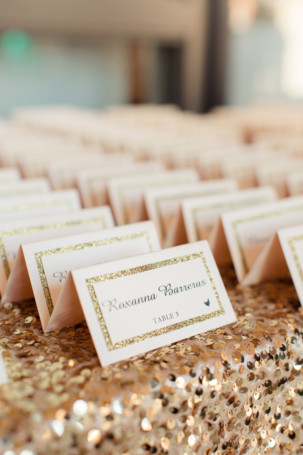 pink and gold wedding escort cards