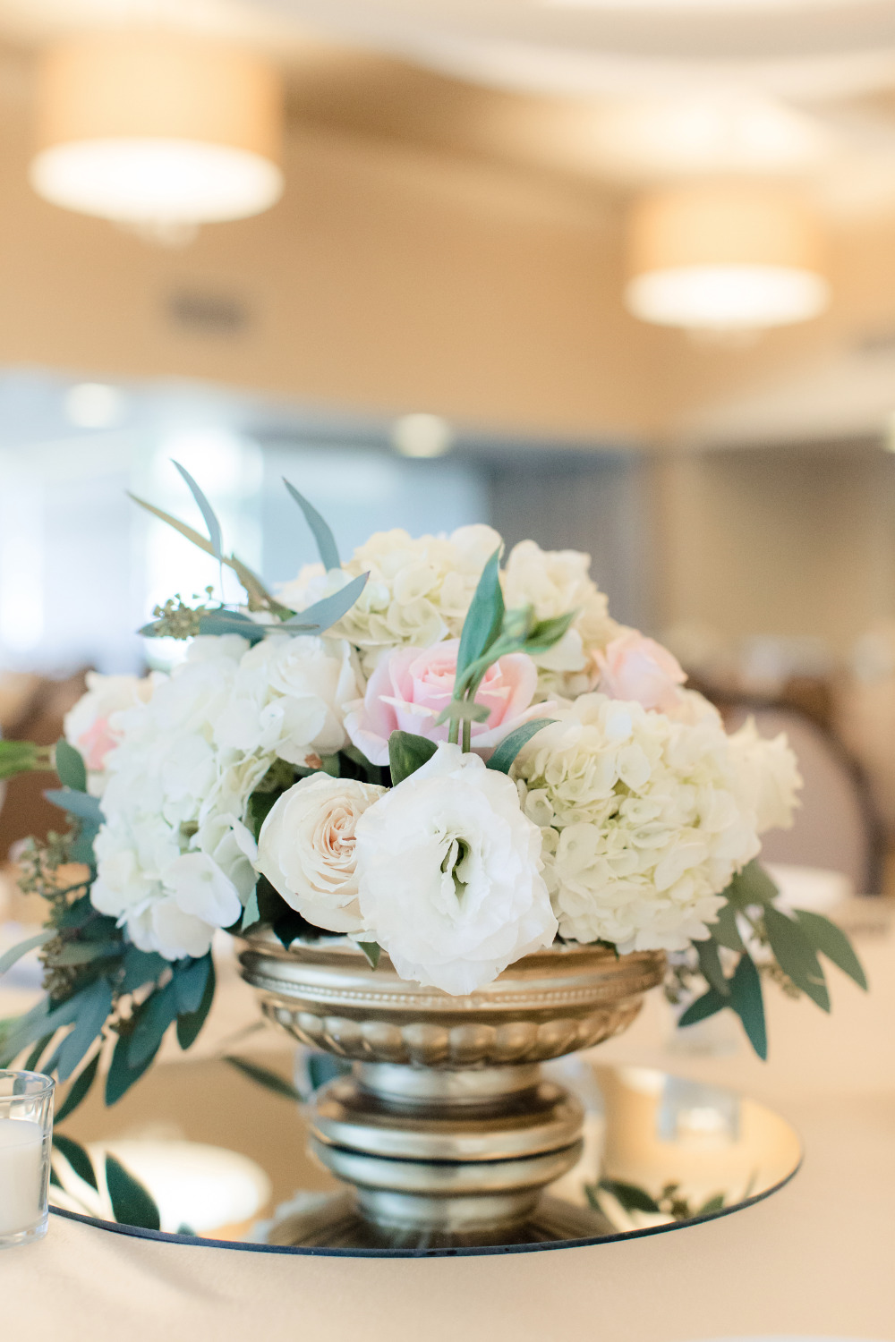 flower centerpiece in gold vase