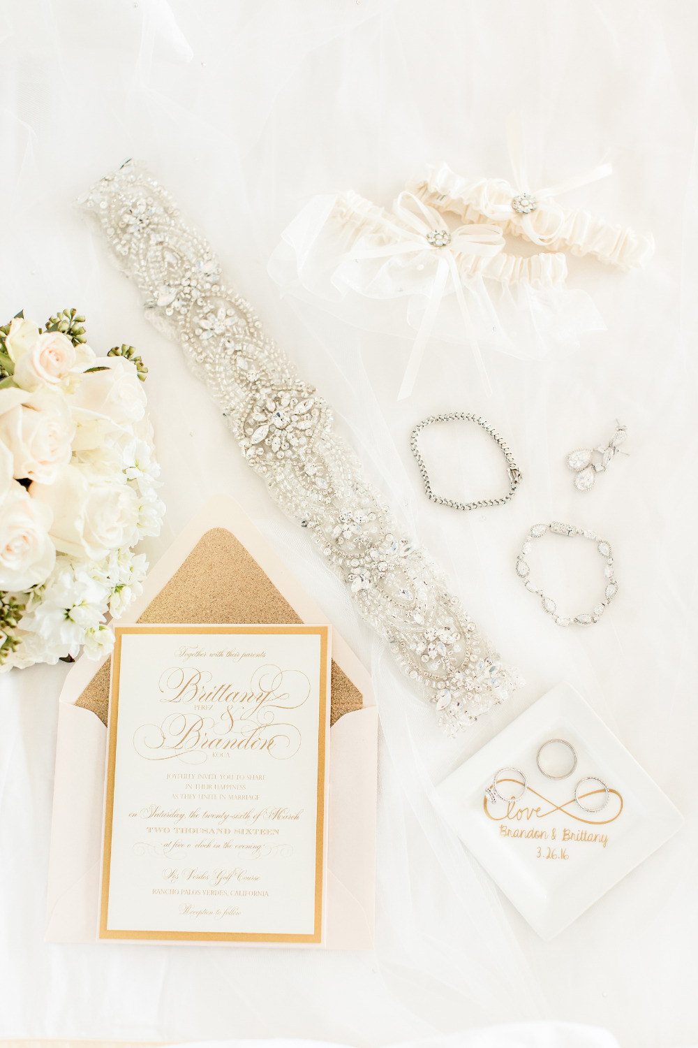 wedding accessories and gold invites