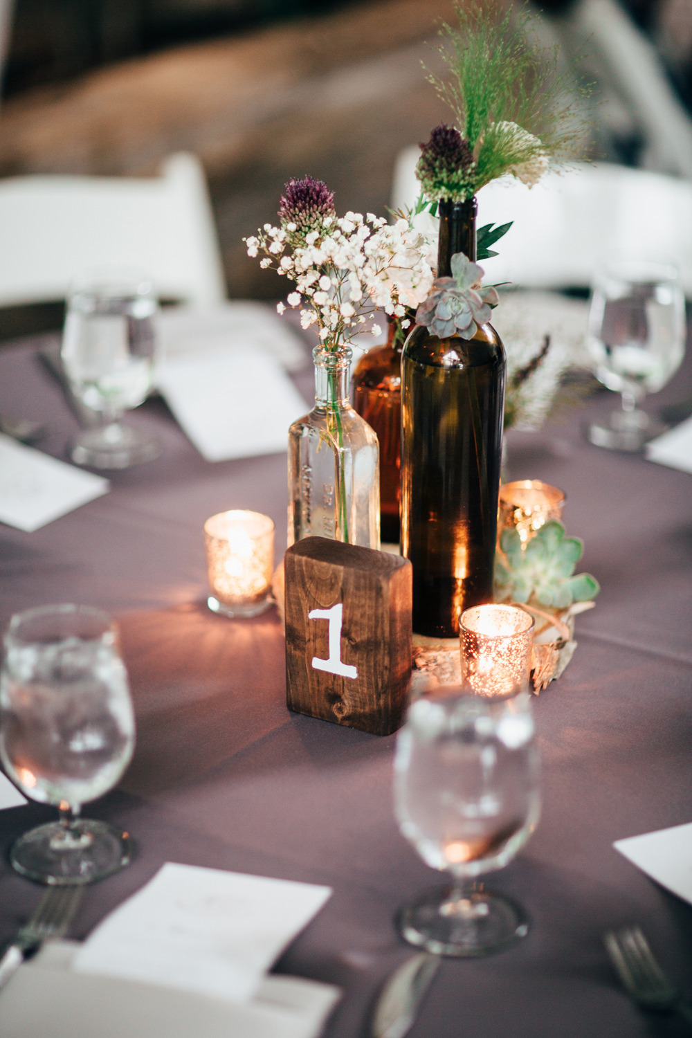 vintage bottle centerpiece with wood table number