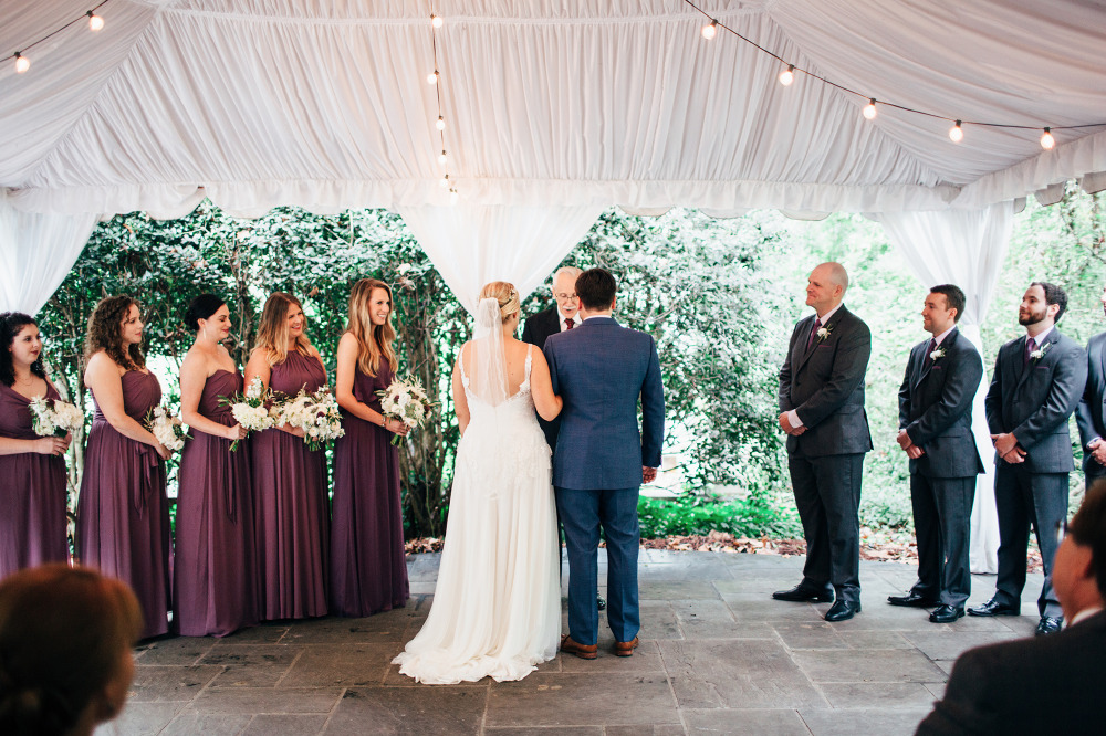 wedding ceremony under a pretty tent