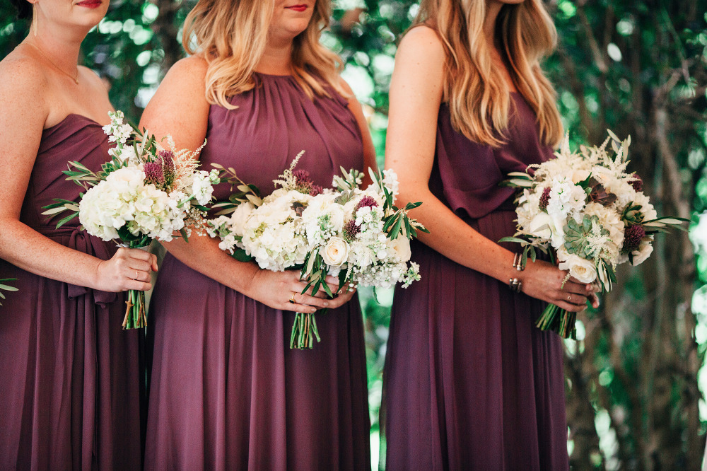 purple bridesmaid dresses with white bouquets
