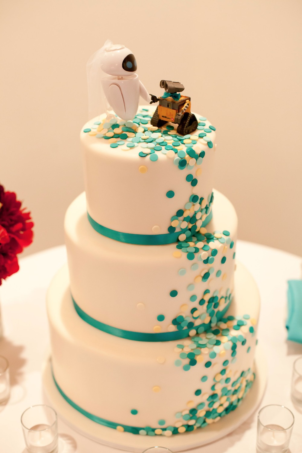 cute confetti wedding cake with Wall-E themed cake topper
