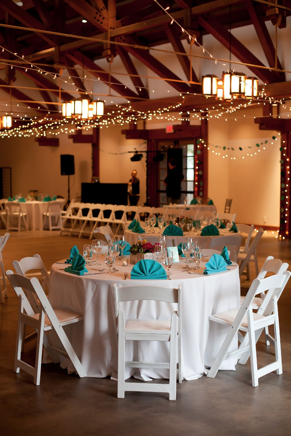 twinkle lights and teal and white reception decor