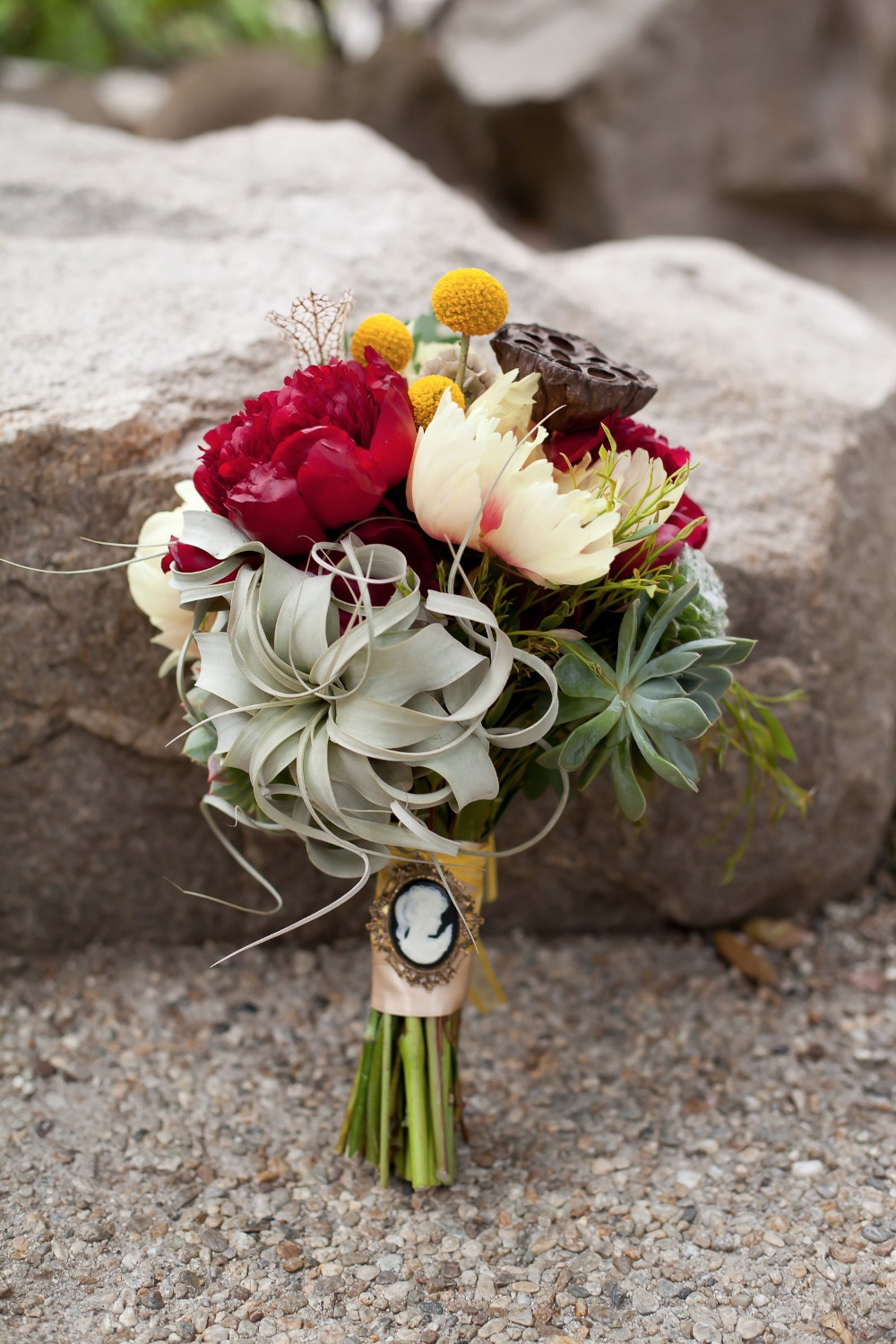 air plant peony and succulent bouquet with broach bouquet wrap
