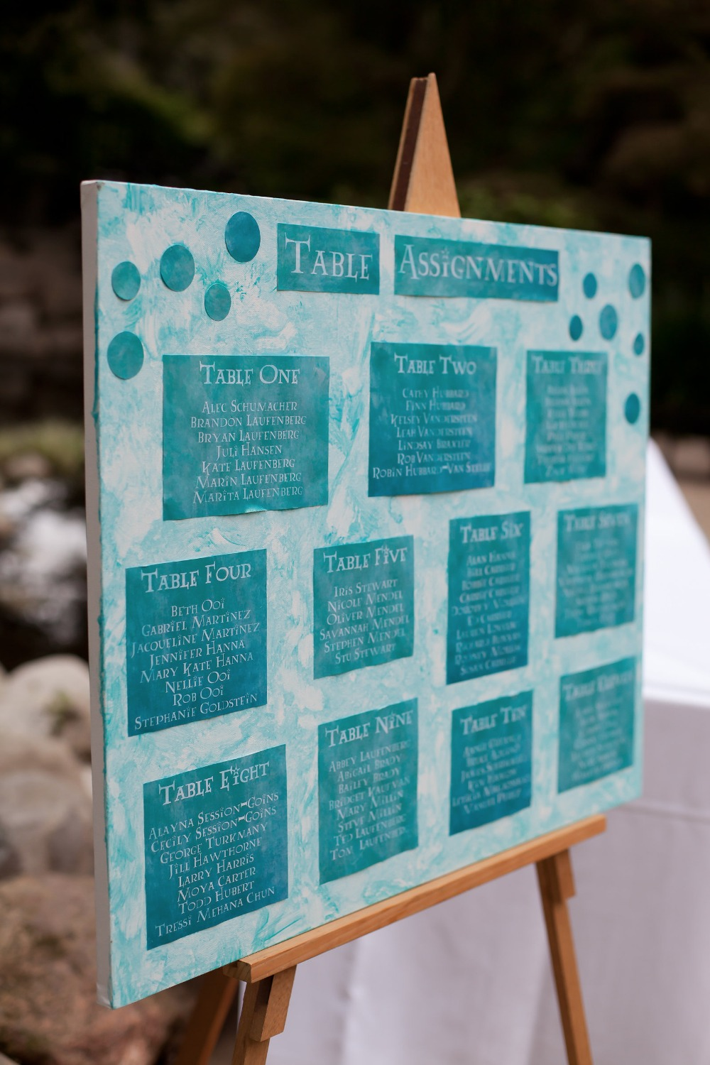 teal wedding seating assignment display