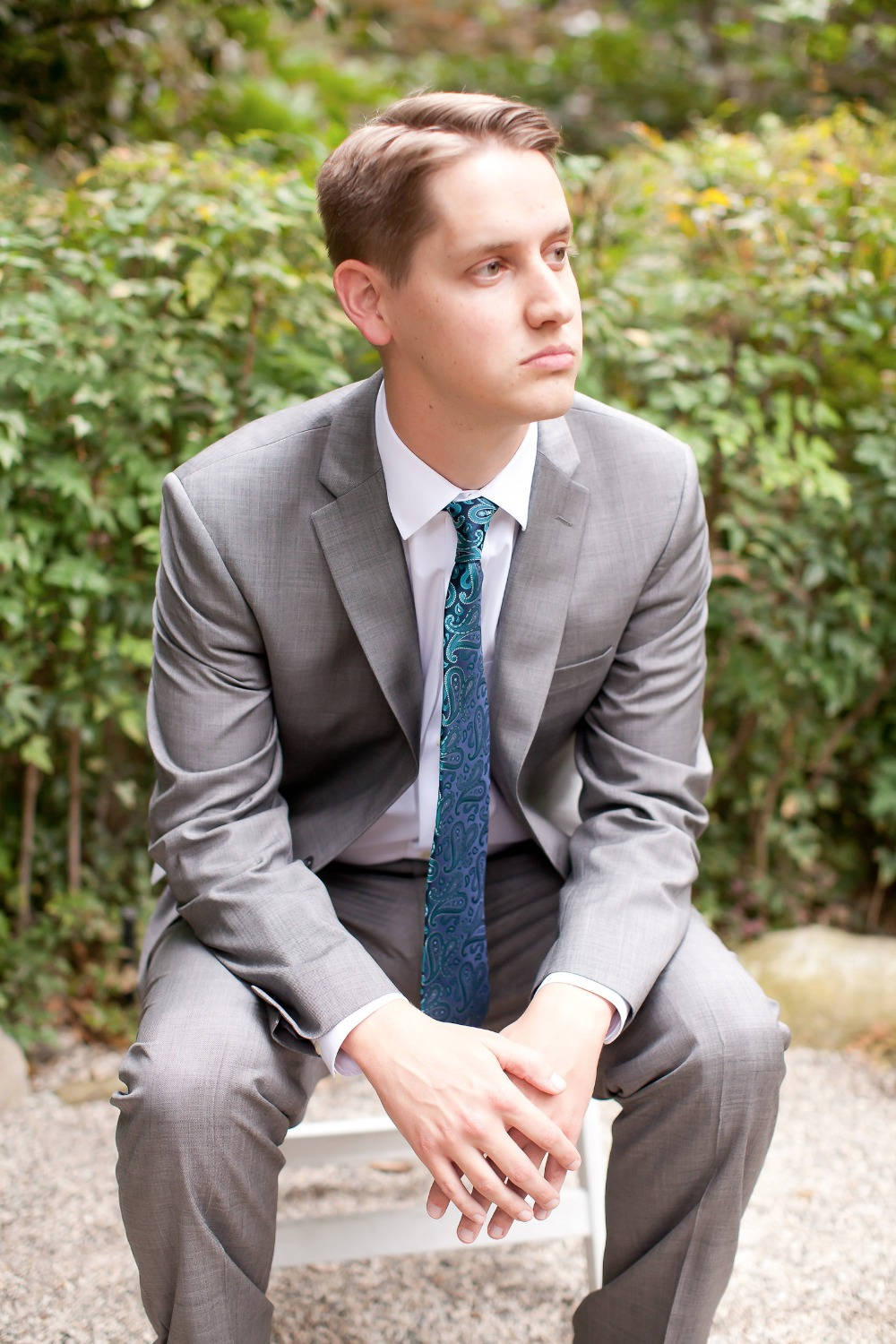 groom in light grey suit and ocean blue tie